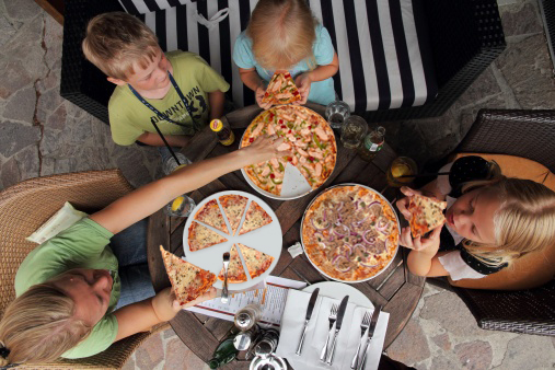 Childrens eating pizza
